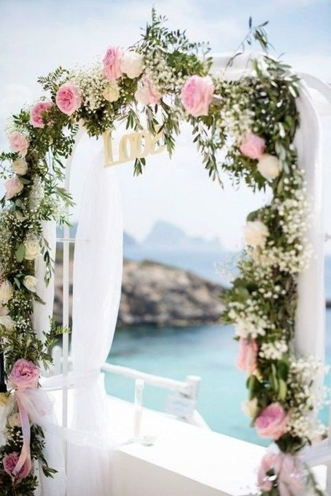pink and ivory flowers for wrapping the wedding arch