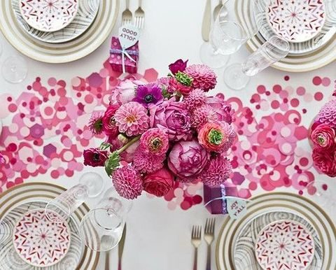 pink and white tablescape with a paper table runner