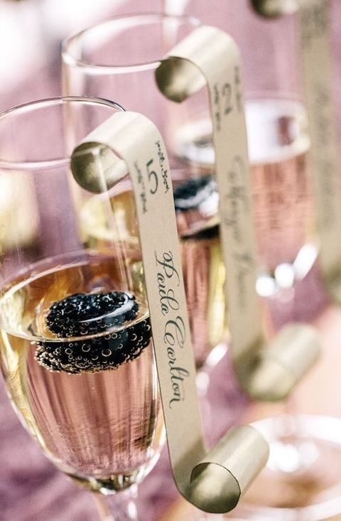pink champagne escort cards with blackberries