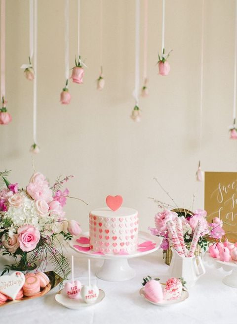 pink dessert table with lots of flowers