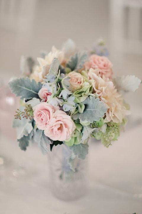 pink flowers and greyish leaves in a bouquet