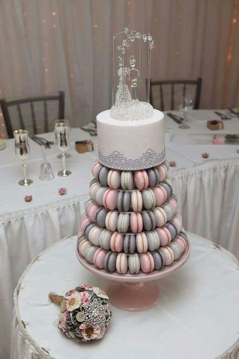 pink, grey and ivory macarons together with a grey lace cake