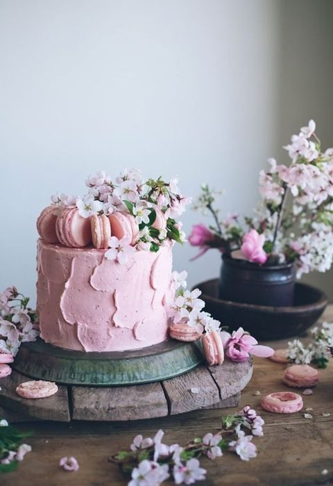 pink sweet cake with macarons and flowers
