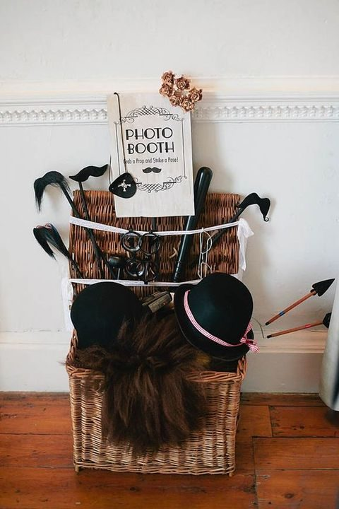 place photo booth props into a basket