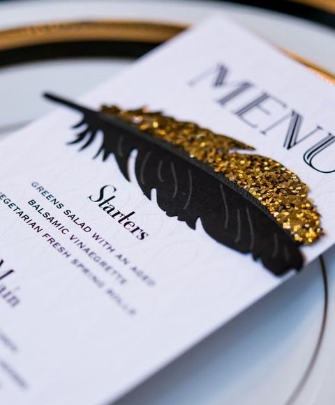 printed meus with black and gold glitter feathers