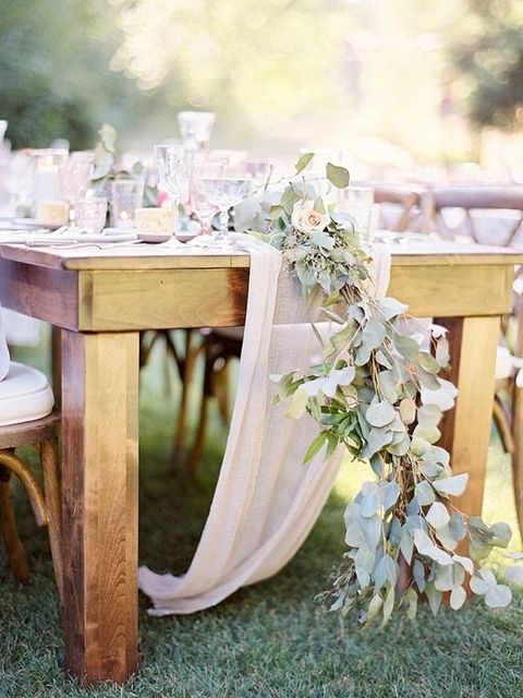 rustic garland of leaves and blush flowers on a tulle runner