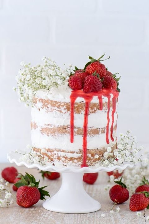 semi naked drip wedding cake topped with strawberries