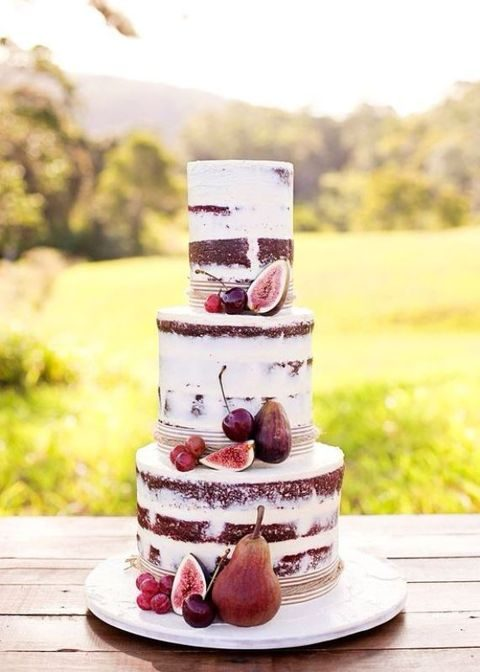semi naked fall wedding cake topped with figs and cherries
