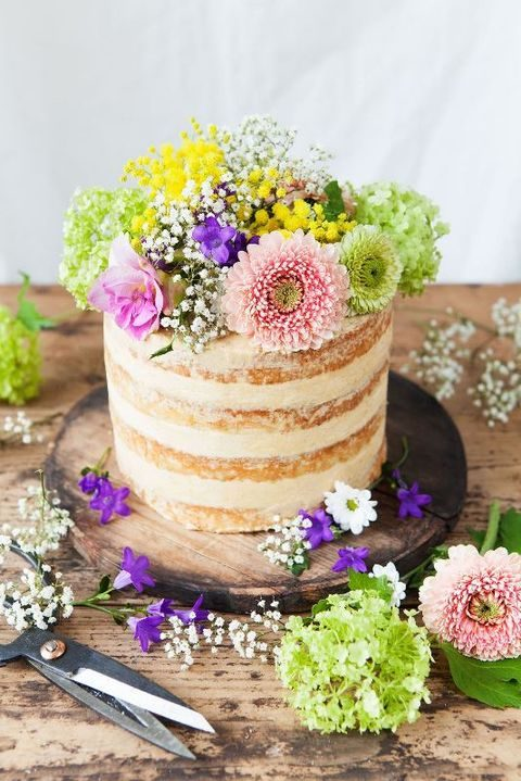semi naked summer cake with colorful blooms