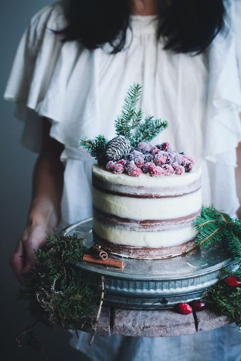 semi naked wedding cake with cranberries and pinecones