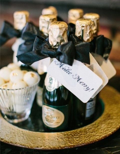small champagne bottles with black bows as wedidng favors
