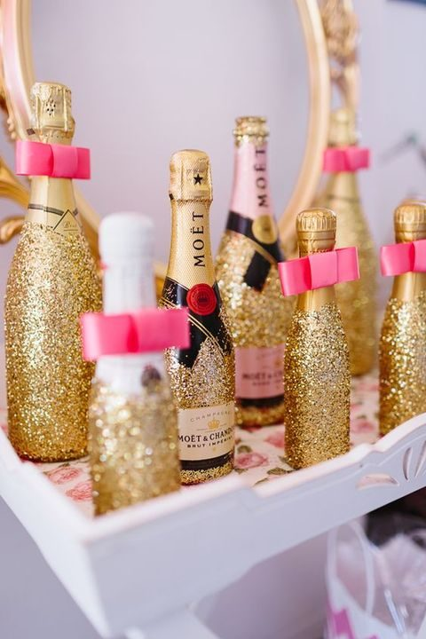 small glitter champagne bottles as party favors