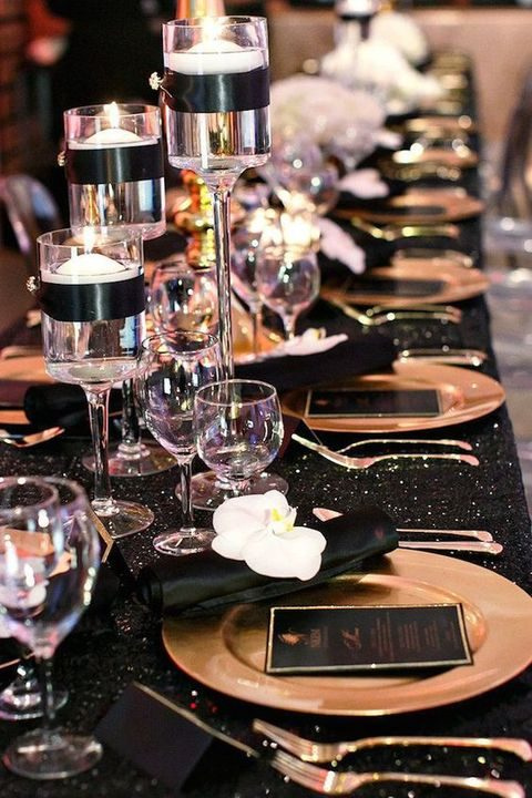sparkling black tablecloth, white orchids and gold chargers