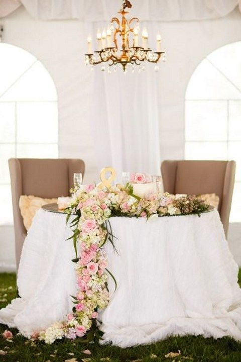 spring flower garland on a sweetheart table