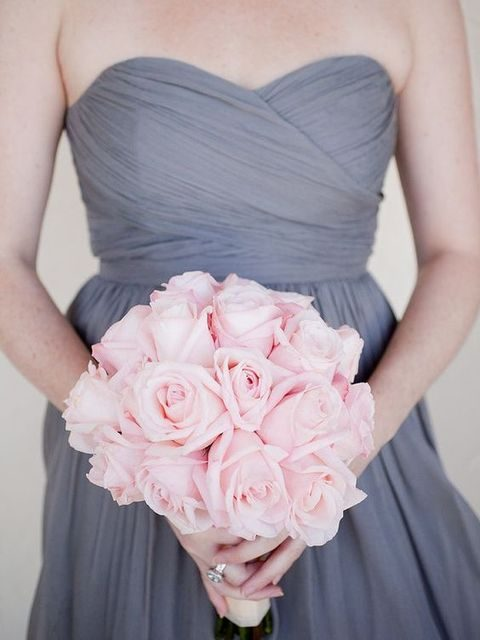 strapless grey bridesmaid's dress and a pink rose bouquet