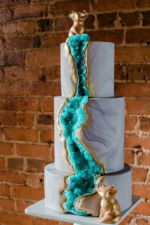 stunning blue marble cake with green geode decor