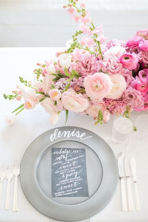 table setting with an ombre pink and blush flower centerpiece