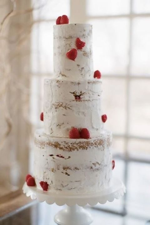 tall semi naked cake decorated with strawberries