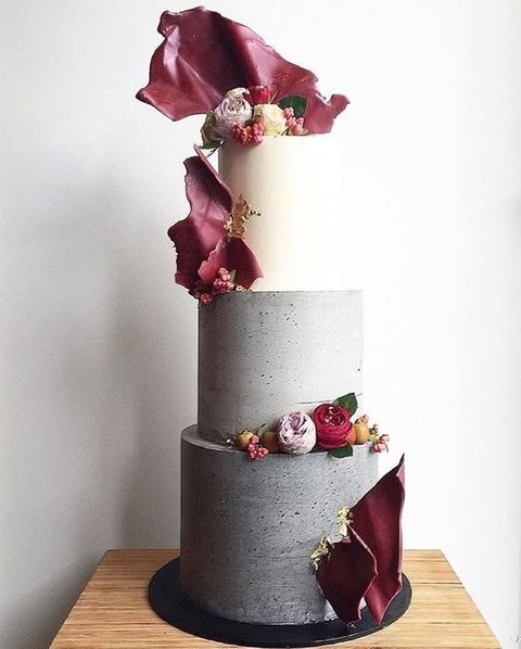 textural concrete-inspired wedidng cake with flowers and marsala decor