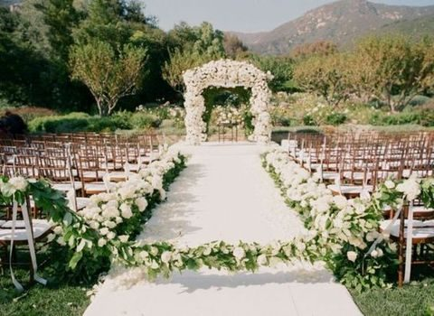 white and green garland to cover the aisle
