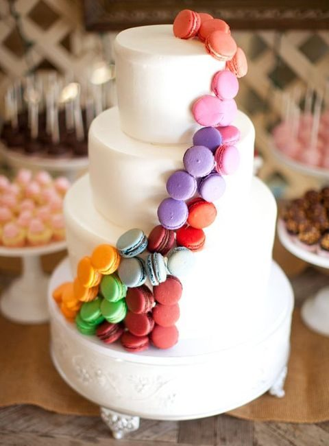 white cake topped with tiny colorful macarons