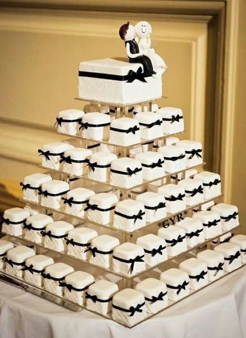 white individual square cakes wwith black bows