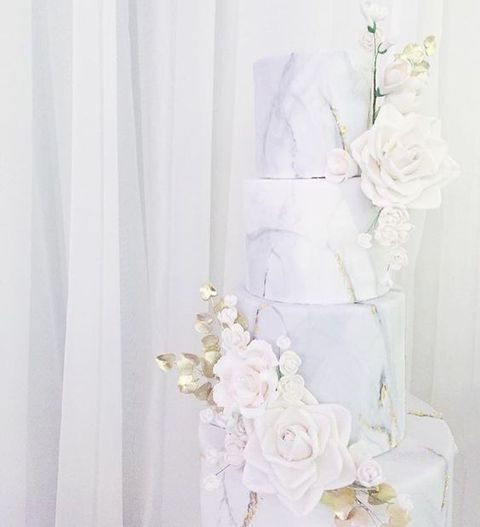 white marble wedding cake topped with flowers
