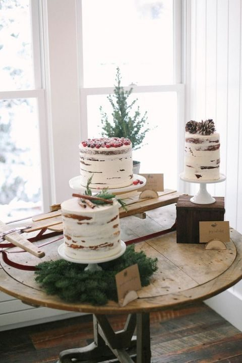 winter semi naked cakes topped with cinnamon, pinecones and cranberries