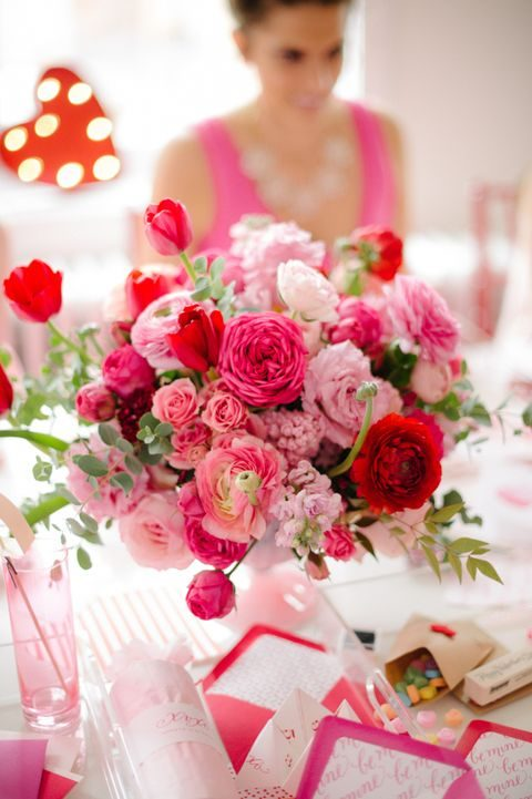 a lush pink and red flower centerpiece