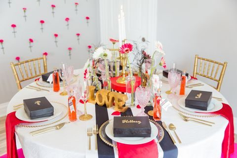 black, white and pink table decor with gold touches