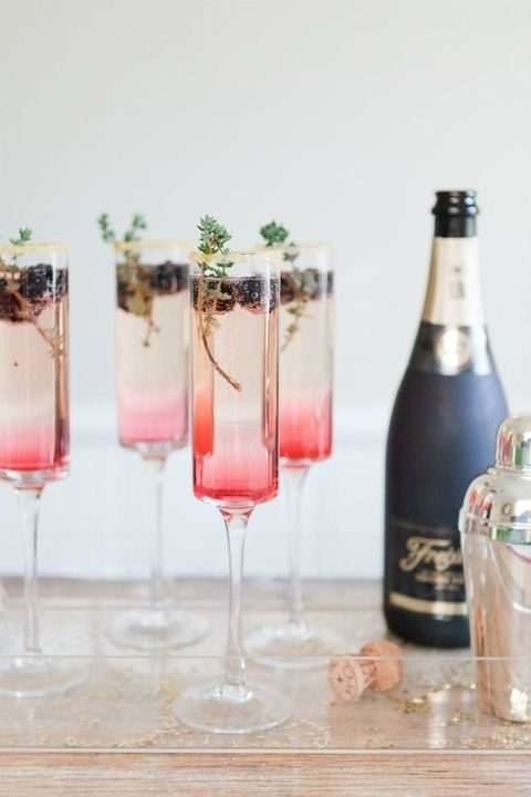 champagne cocktails with blackberries