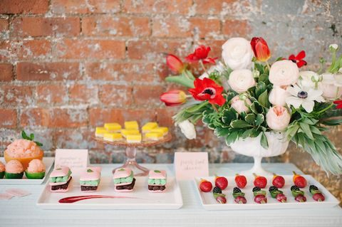 colorful dessert table with a lush floral decoration