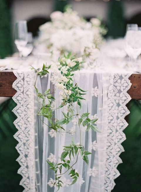 crispy white lace fabric runner with greenery and white flowers