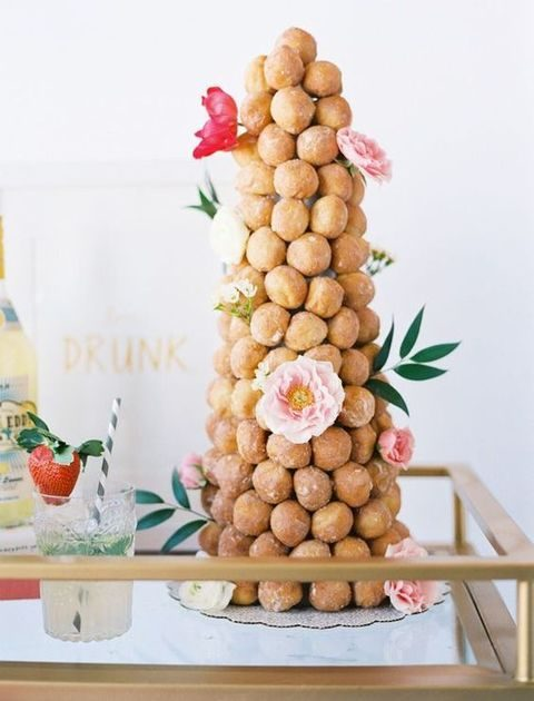 croquembouche decorated with flowers is a cute idea