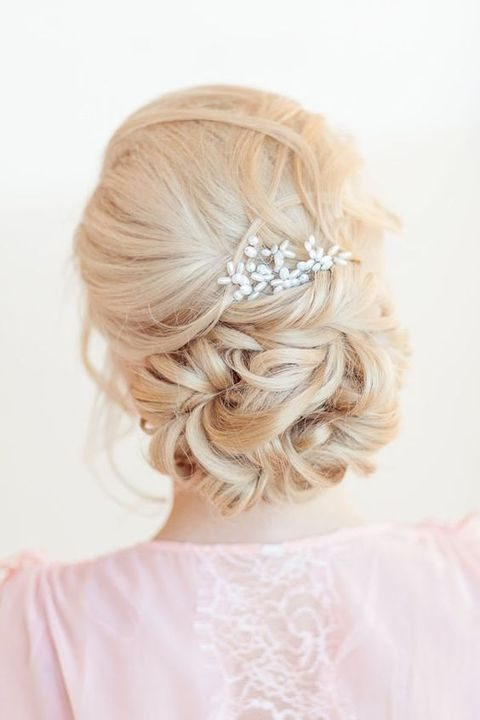 curly updo on long hair with a beaded headpiece