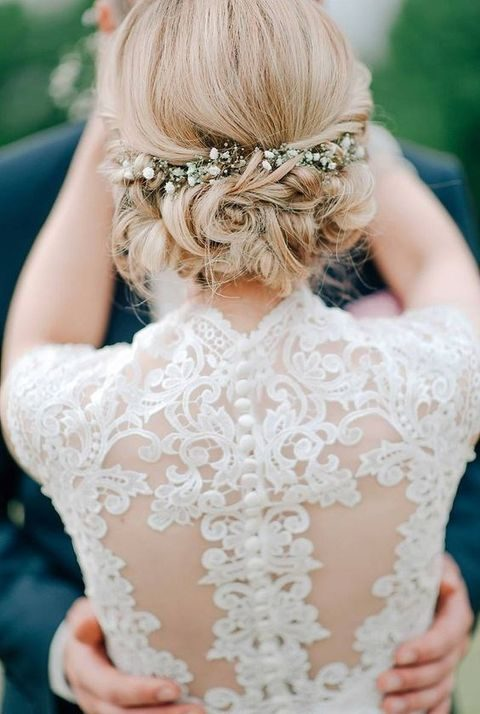 curly updo with fresh flowers
