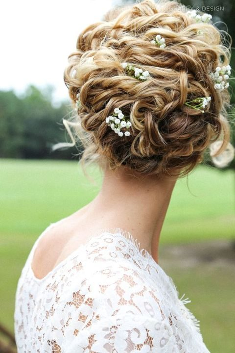 curly wedding updo with baby's breath
