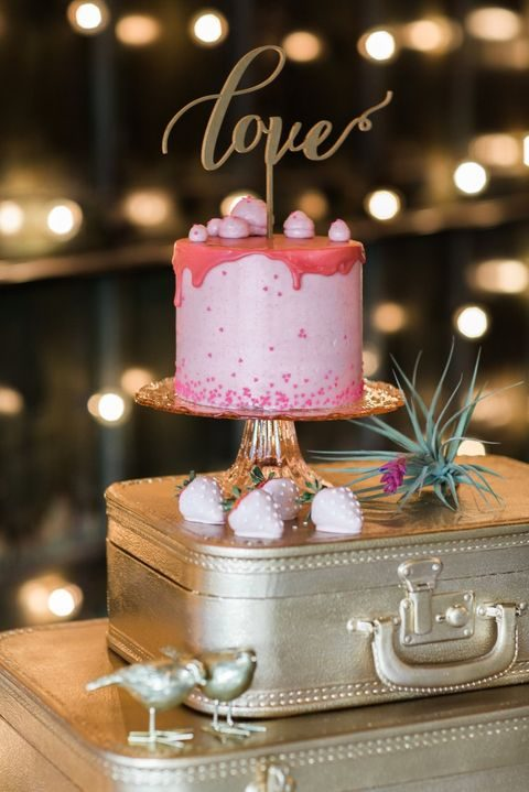 cutest pink drip cake with a gold topper