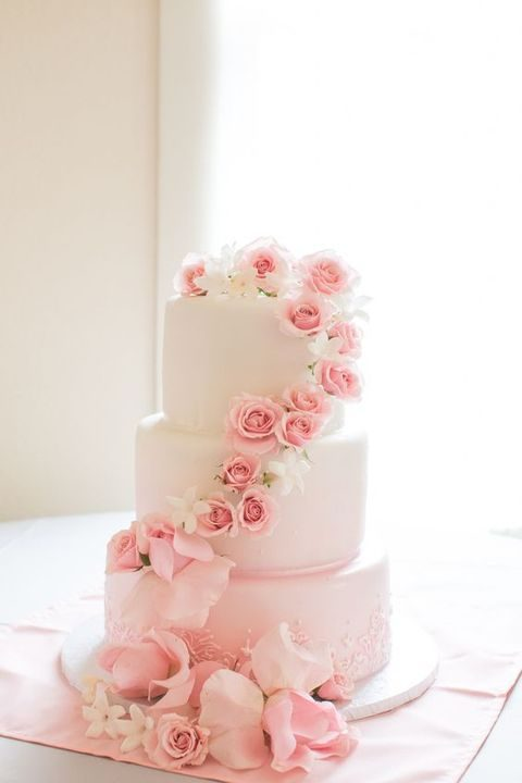 decorate a plain cake with pink roses to make it romantic
