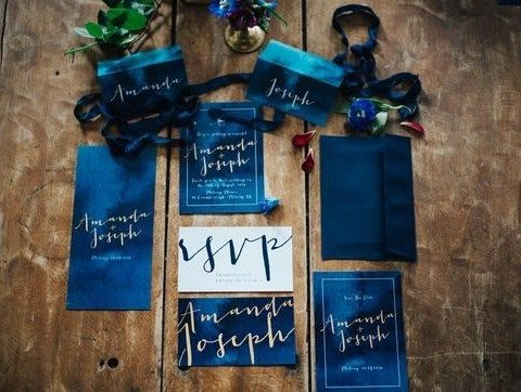 deep blue wedding stationary with gold calligraphy