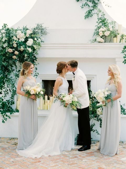 elegant outdoor ceremony spot with lush florals and greenery