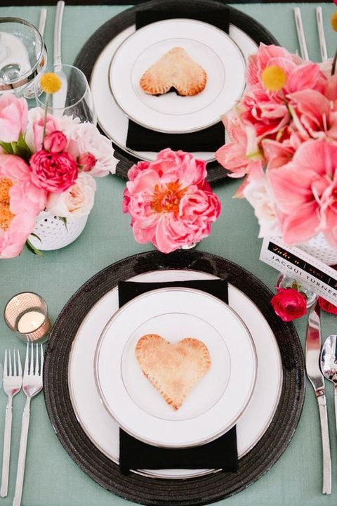 elegant place settings with pink flowers