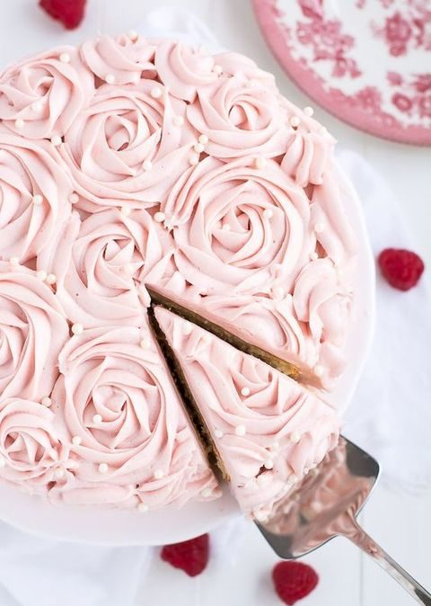 elegant raspberry cake with rose cream topping