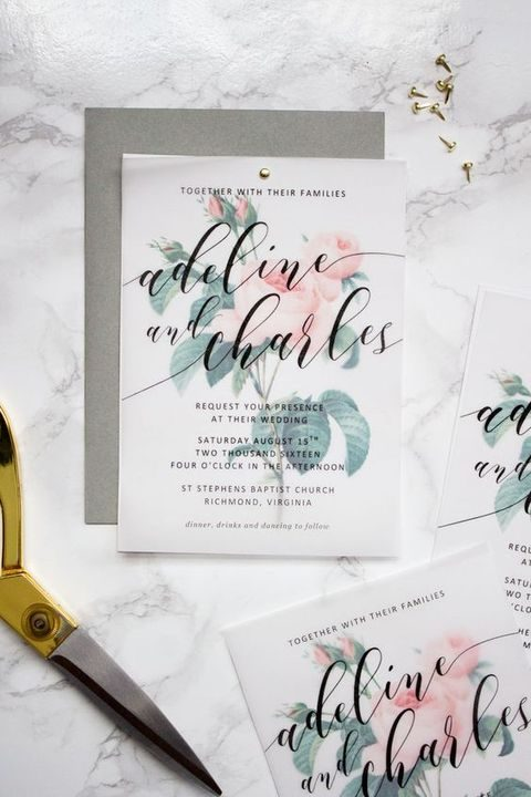 floral invitation with black calligraphy