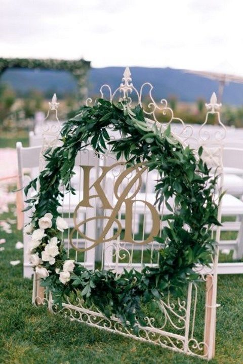 fresh greenery, white flowers and monograms
