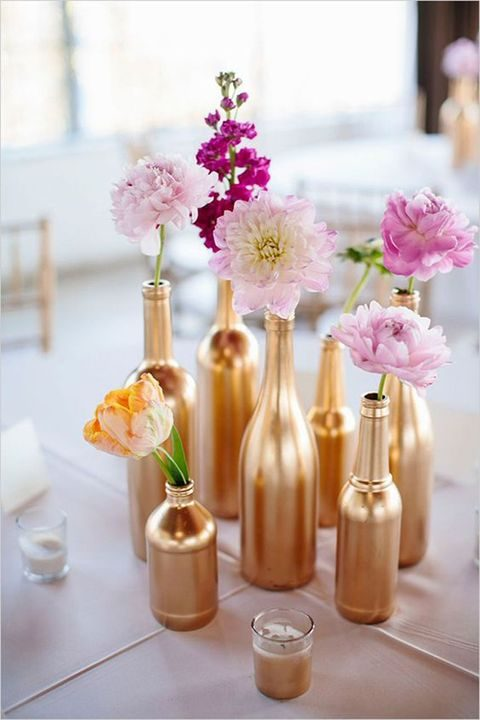 gilded bottles with pink and purple flowers