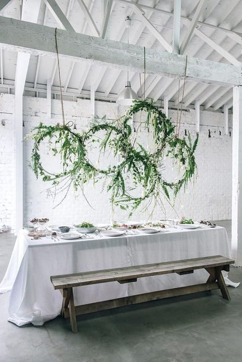 greenery and leaf wreaths over the reception