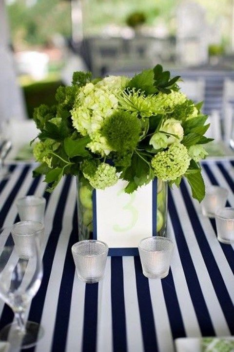greenery and yellow centerpieces look great with navy and white