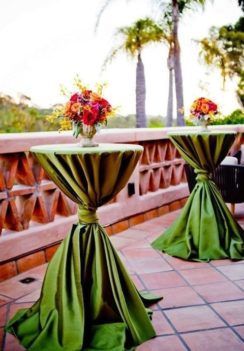 greenery-colored tablecloths and bold flowers