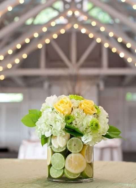 greenery, yellow and ivory centerpiece